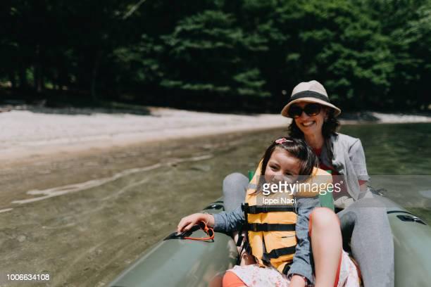 Mother and child enjoying ride on inflatable raft, Lake Chuzenji, Nikko