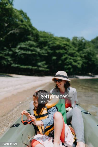 Mother and child enjoying ride on packraft, Lake Chuzenji, Nikko