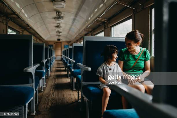Mother and child enjoying train ride