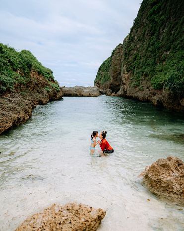 Mother and child enjoying tropical water, Okinawa, Japan - gettyimageskorea