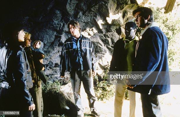 SLIDERS Mother and Child Episode 14 Pictured Kari Wuhrer as Capt Maggie Beckett Natalie Radford as Christina Griffin Charlie O'Connell as Colin...