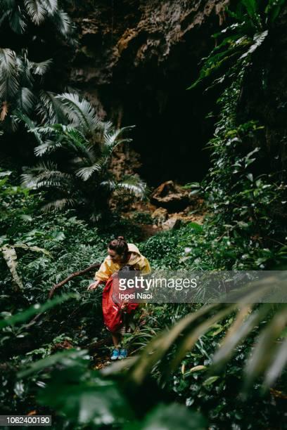 Mother and child exploring jungle, Okinawa, Japan