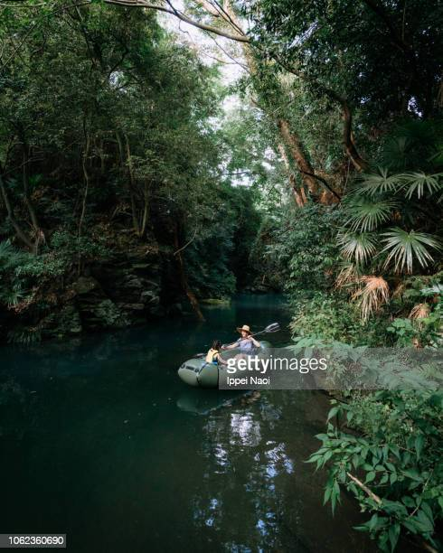 Mother and child exploring rainforest river by kayak, Saitama, Japan