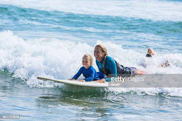 Mother and Child Going Surfing at the Beach