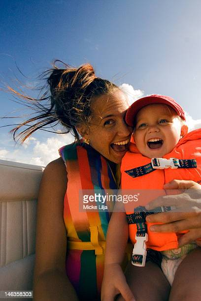 Mother and child happy in boat