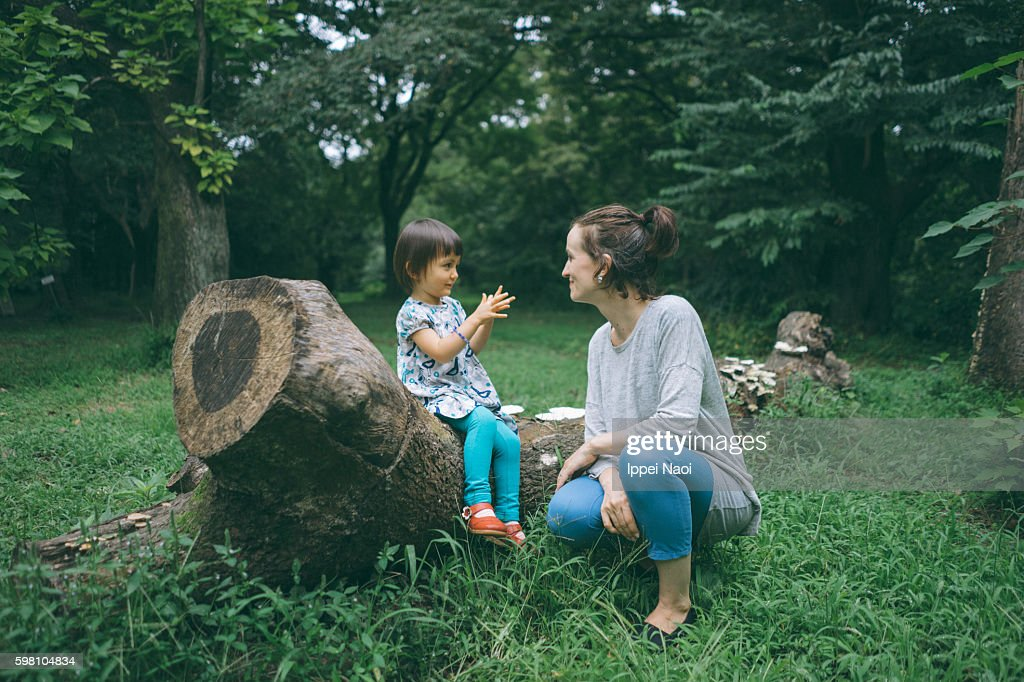Mother and child having conversation in nature : Stock Photo