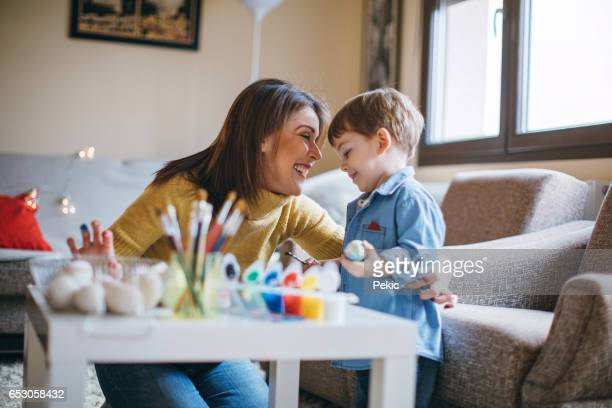 Mother and Child Having Fun Colouring Easter Eggs