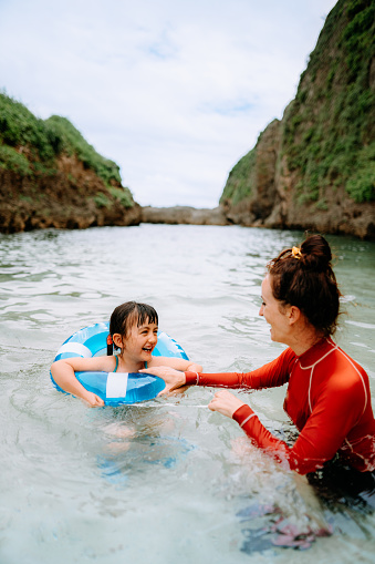 Mother and child having fun in tropical water, Okinawa, Japan - gettyimageskorea