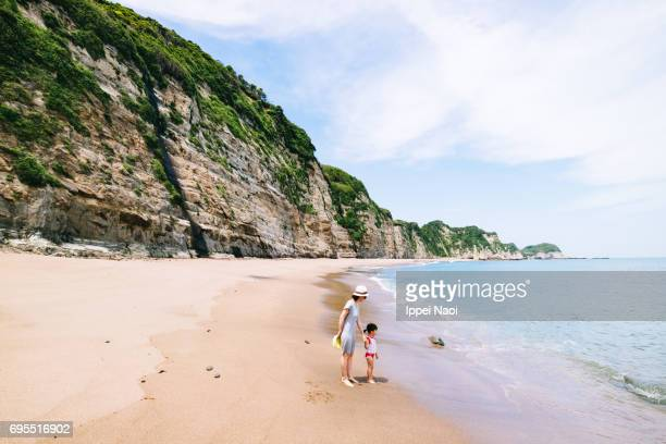 Mother and child having fun on beautiful beach, Chiba, Japan