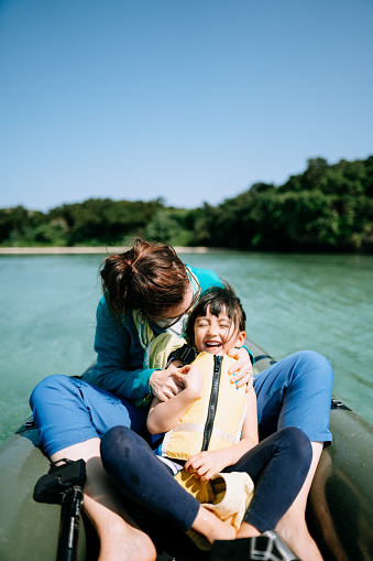 Mother and child having fun on kayak on clear tropical water, Ishigaki Island, Japan - gettyimageskorea
