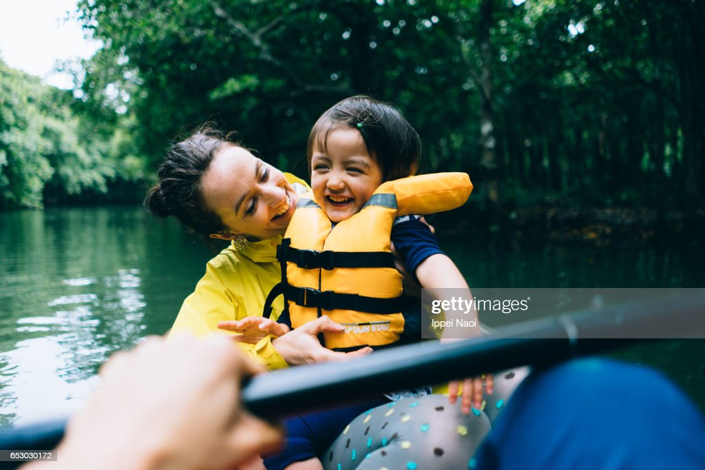 Mother and child having fun with mangrove river kayaking : Stock Photo