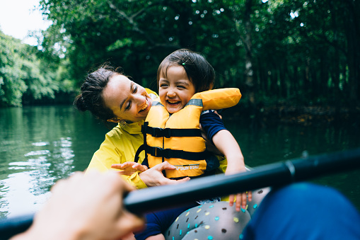 Mother and child having fun with mangrove river kayaking - gettyimageskorea