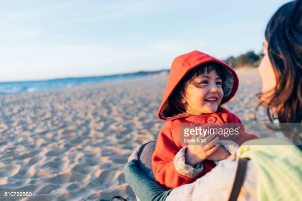 Mother and child having intimate moment on beach