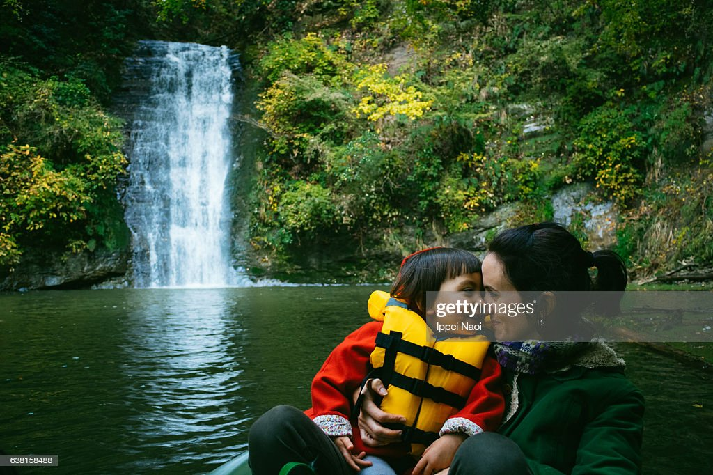 Mother and child having intimate moment on kayak : Stock Photo