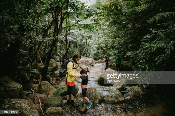 Mother and child hiking in jungle, Ishigaki Island, Okinawa, Japan