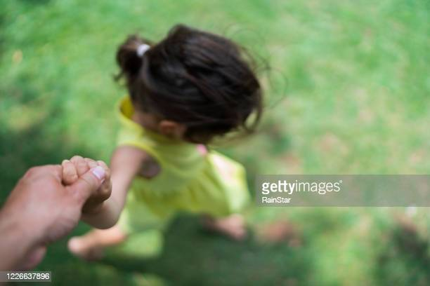mother and child holding hands - unrecognisable person stock pictures, royalty-free photos & images