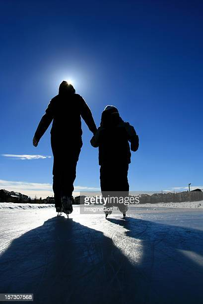 Mother and Child Ice Skating Silhouette