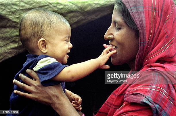 Mother and child in a intimate mood Dhaka Bangladesh April 21 2007