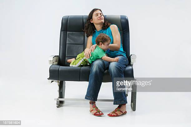 Mother and child in aircraft sleeping