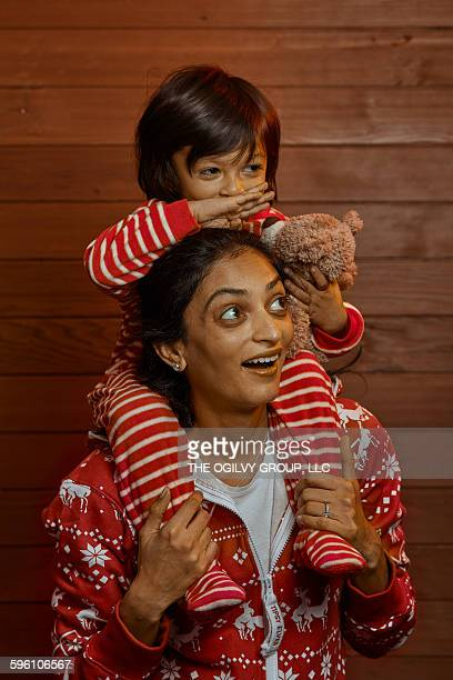 mother and child in holiday pajamas. - yawning mother child stock photos and pictures