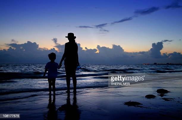 mother and child in the beach