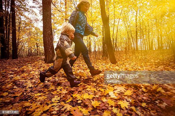 Mother and child in the park in autumn day
