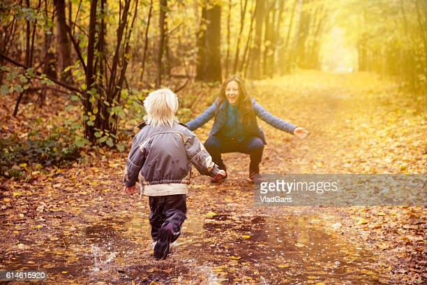 mother and child in the park in autumn day - mother son shower stock photos and pictures