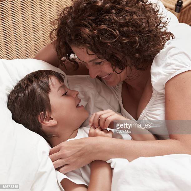 Mother and child lying in bed