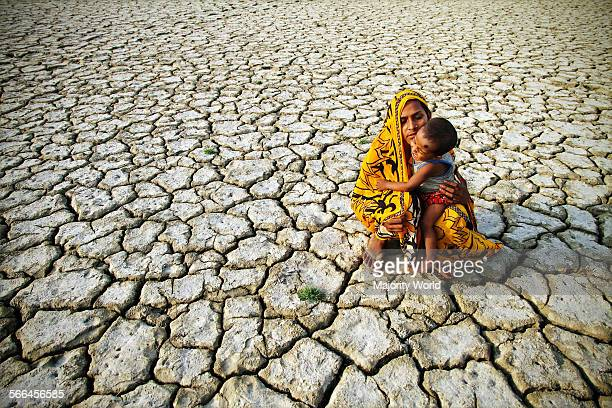Mother and child on a dry land in kattali Chittagong Bangladesh March 30 2012