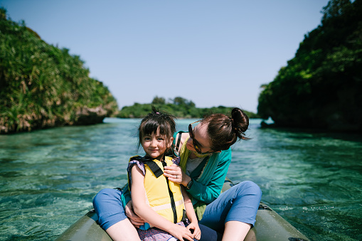 Mother and child on kayak on clear tropical water, Ishigaki Island, Japan - gettyimageskorea