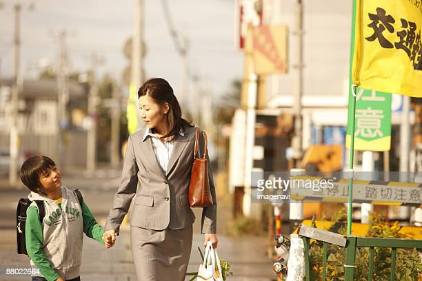 mother and child on their way home - japan mom and son stock photos and pictures