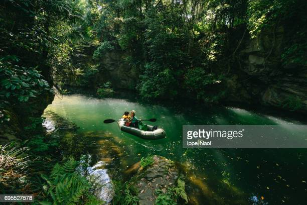 mother and child paddling a packraft together in beautiful river gorge, japan - 埼玉県 ストックフォトと画像