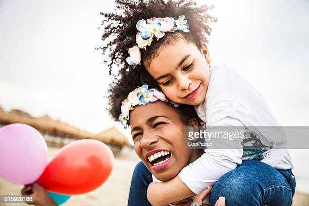 Mother and child play together celebrating