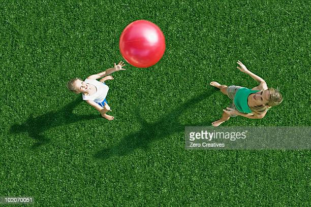 Mother and child playing ball
