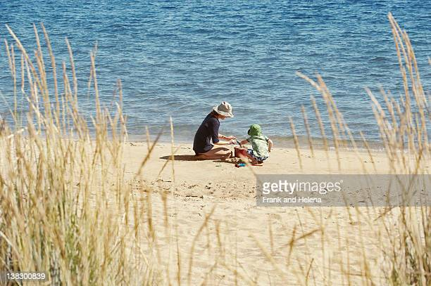 Mother and child playing on beach