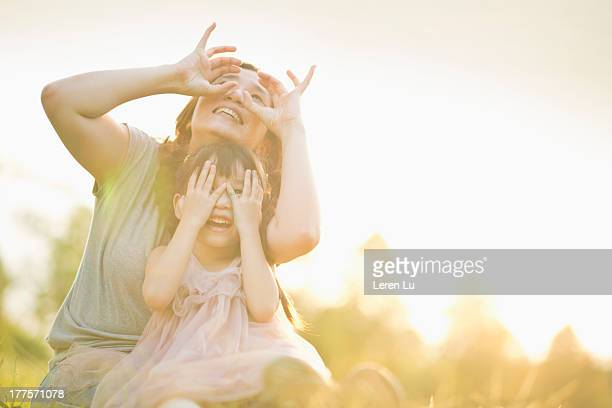 Mother and child playing under sunset
