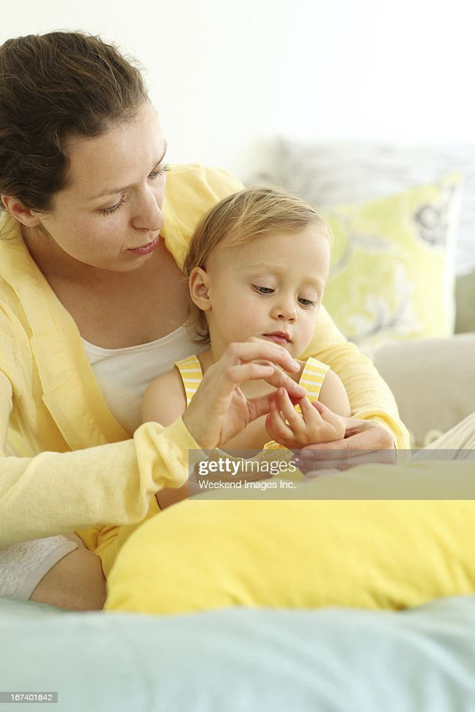 Mother and child playing with fingers : Stock Photo