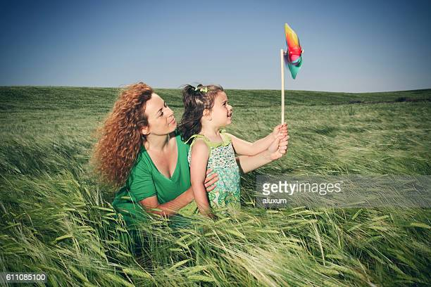 mother and child playing with toy windmill