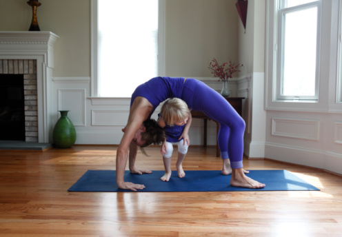 Mother and child practicing yoga and playing - gettyimageskorea