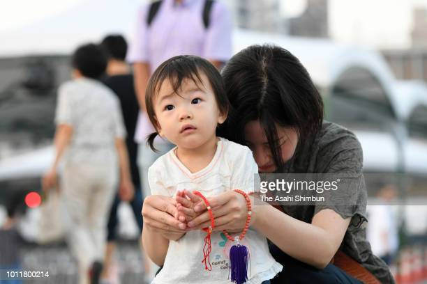 A mother and child pray before the cenotaph for the ABomb victims prior to the Peace Memorial Ceremony at Hiroshima Peace Memorial Park on August 6...