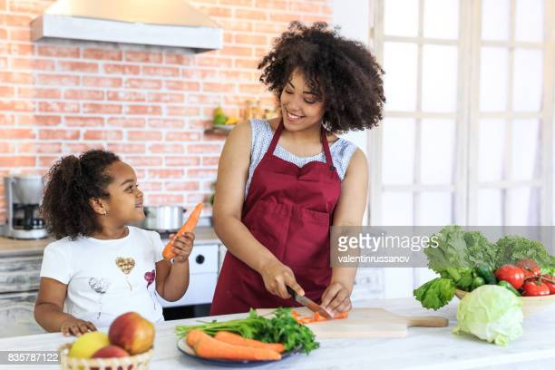 Mother and child preparing healty meal