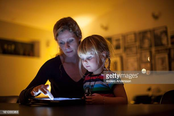 Mother and child reading/playing on ipad