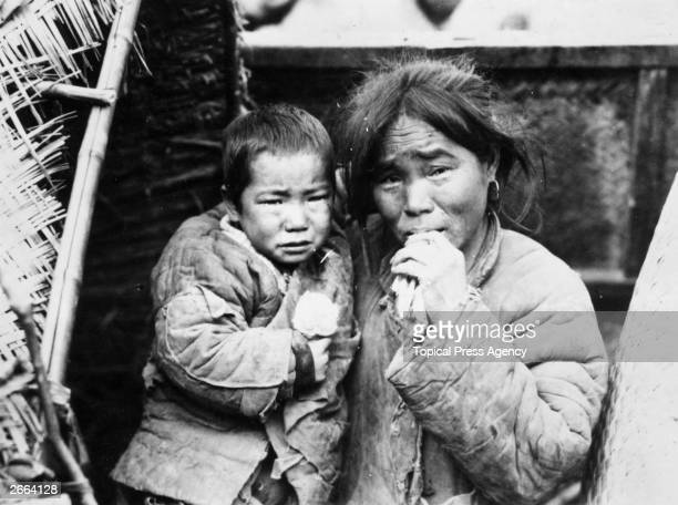 A mother and child refugees from Shantung during the famine in China