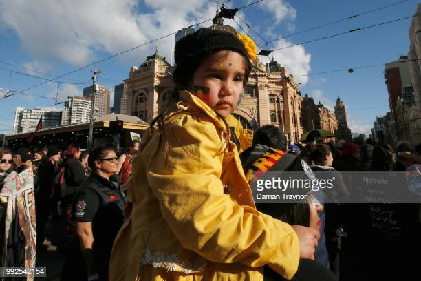 A mother and child take part in the NAIDOC march on July 6 2018 in Melbourne Australia The march marks the start of NAIDOC Week which runs this year...