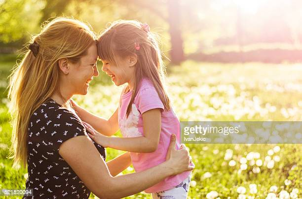 Mother and child together in nature in springtime