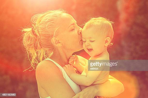 Mother and child together in the park emotive moment