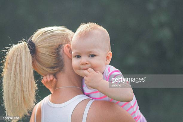 Mother and child together in the park leisure time