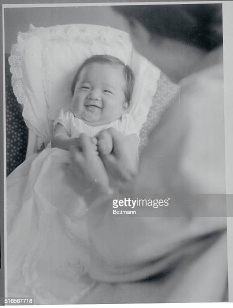 Mother and Child Tokyo Japan A big smile lights up Prince Aya Laug's face as he grips his mother's thumbs before grasping chopsticks for the first...