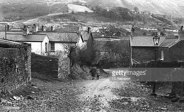 A mother and child walk down a street in November 1966 in the mining town of Aberfan South Wales