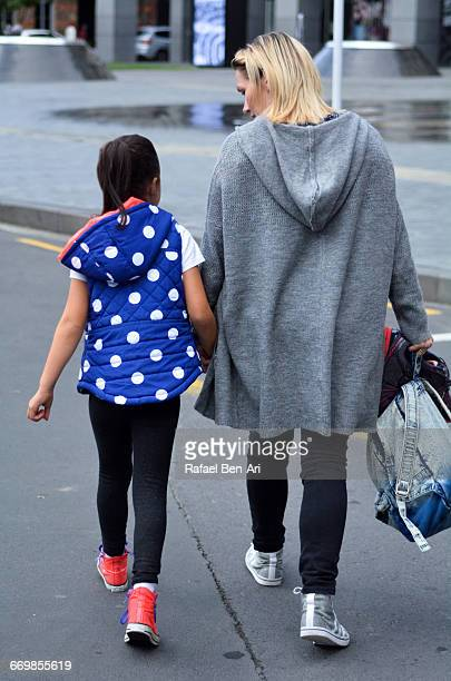 mother and child  walks down the street together - rafael ben ari stock pictures, royalty-free photos & images
